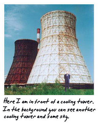 Here I am in front of a large cooling tower. In the background you can see another cooling tower and some sky.